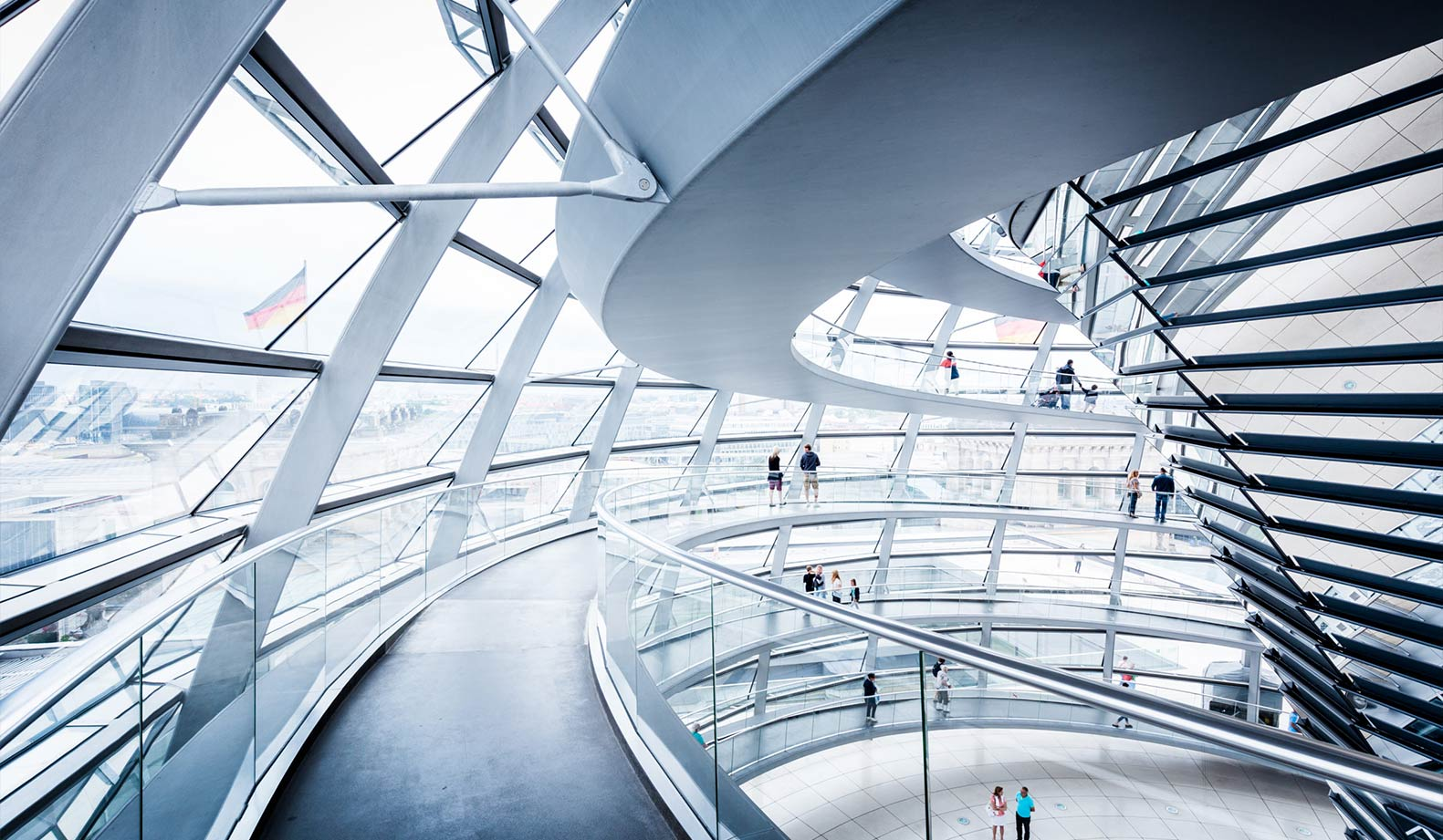 BERLIN - JULY 19, 2015: Interior view of famous Reichstag Dome in Berlin, Germany. Constructed to symbolize the reunification of Germany it's now one of Berlin's most important landmarks.
